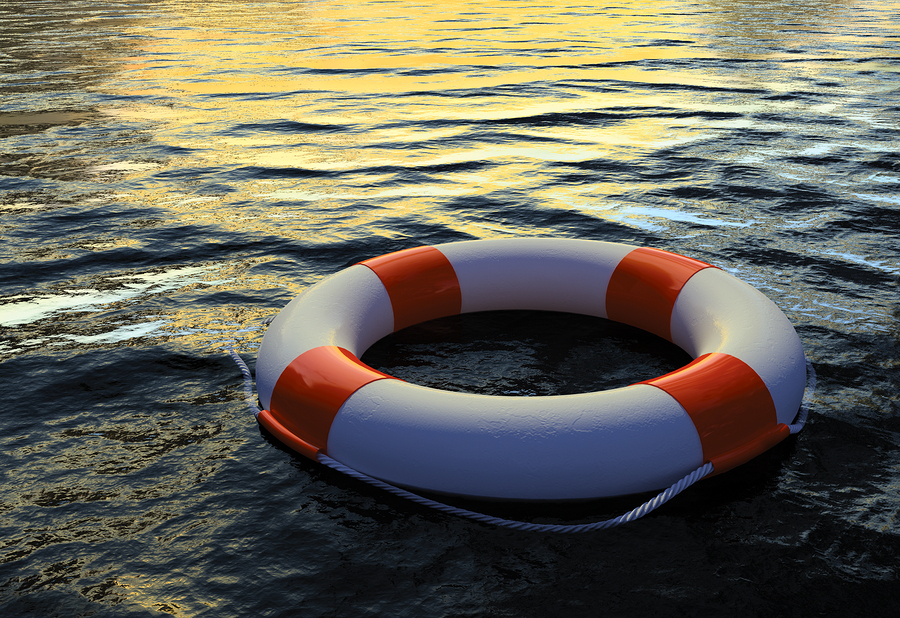 bigstock-Buoy-Ring-floating-on-water--16974902
